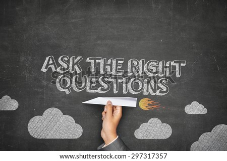 Ask the right questions concept on black blackboard with businessman hand holding paper plane - stock photo