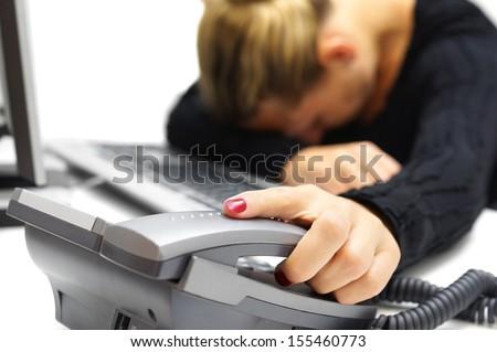 Asleep call center operator at work - stock photo