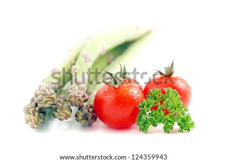 asparagus and tomatoes isolated on a white background - stock photo