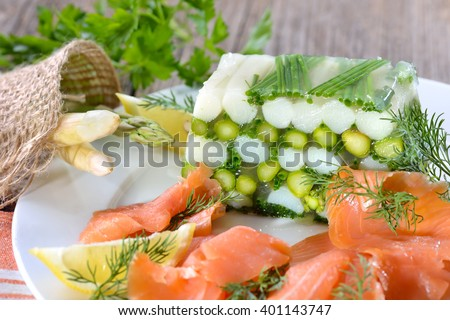 Asparagus jelly with fresh white and green asparagus and chives, served with delicious smoked salmon - stock photo