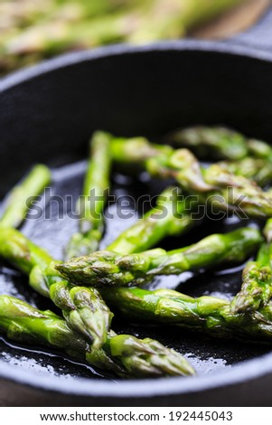 Asparagus on frying pan - stock photo