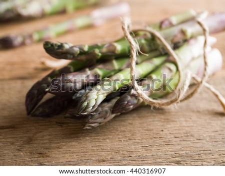 asparagus on wood background - stock photo