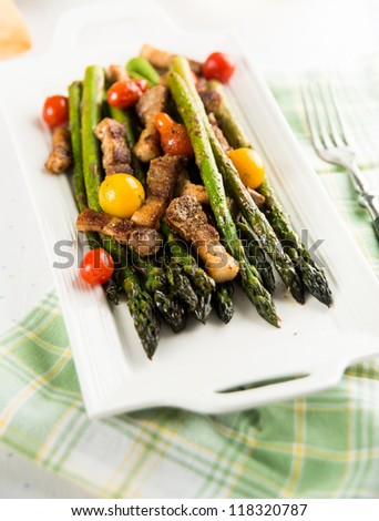 Asparagus Sauteed with Heirloom Cherry Tomatoes and Garlic - stock photo