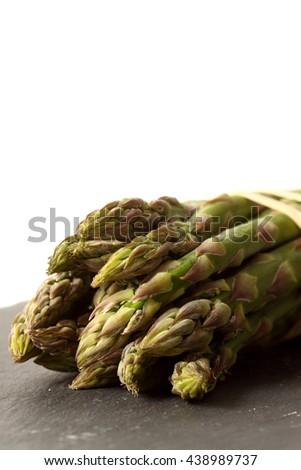 Asparagus slate isolated / A bunch of fresh organic asparagus on slate isolated - stock photo