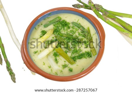 asparagus soup in plate on white background - stock photo