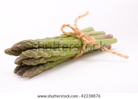 Asparagus spears tied with hemp or sisal string keeping them tidy isolated against white. - stock photo