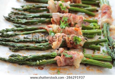 Asparagus with bacon - stock photo