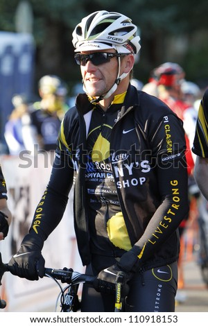 ASPEN - SEPT 25: Lance Armstrong rides in the Wapiyapi Classic in Aspen, Colorado on September 25, 2011 - stock photo
