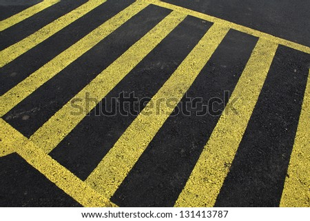 Asphalt as a backdrop. yellow dividing line - stock photo