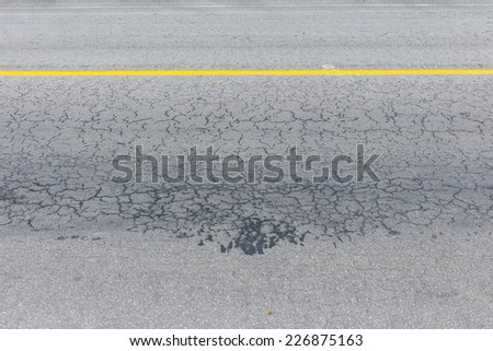 asphalt black road empty with crack damage - stock photo