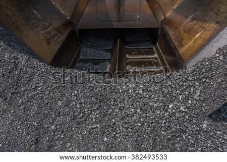 asphalt concrete on pave machine - stock photo