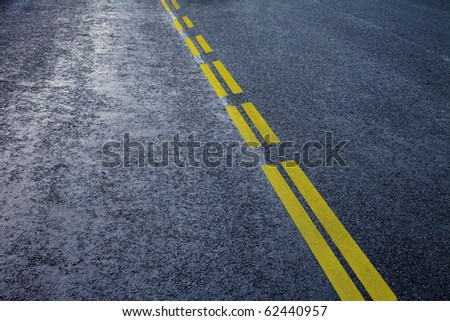 asphalt detail with yelow line - stock photo
