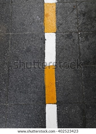 Asphalt foot path texture with white and yellow stripe(line) for warning area. - stock photo