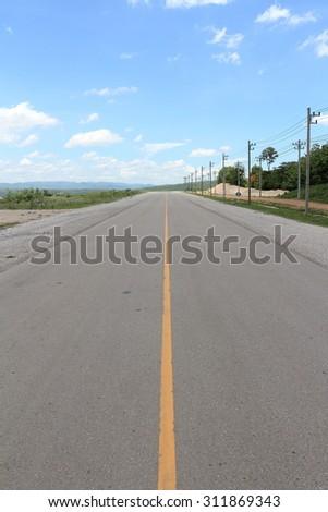 asphalt road against a blue sky - stock photo