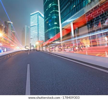 Asphalt road and modern city - stock photo