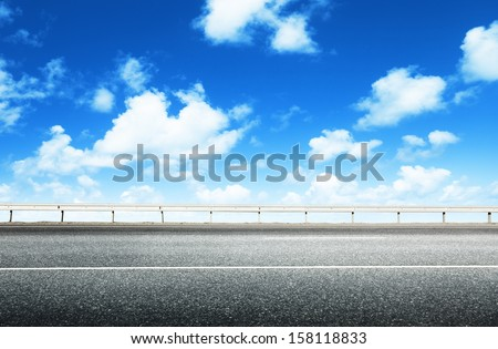 asphalt road and perfect sky - stock photo