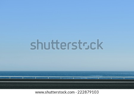asphalt road and sea - stock photo
