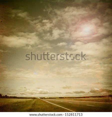 Asphalt Road and Summer Sky in Retro Style - stock photo