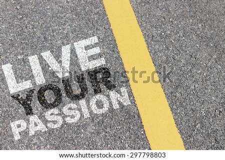 Asphalt road area with yellow stripes and lettering motivation. - stock photo