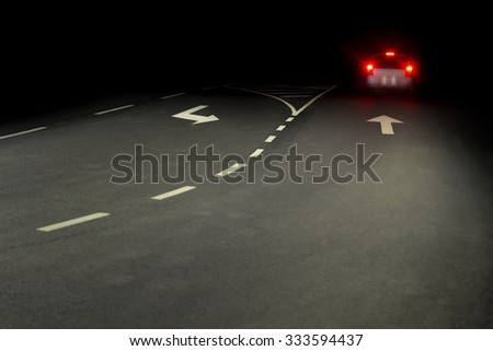 Asphalt road at night, with red rear lights of car - stock photo