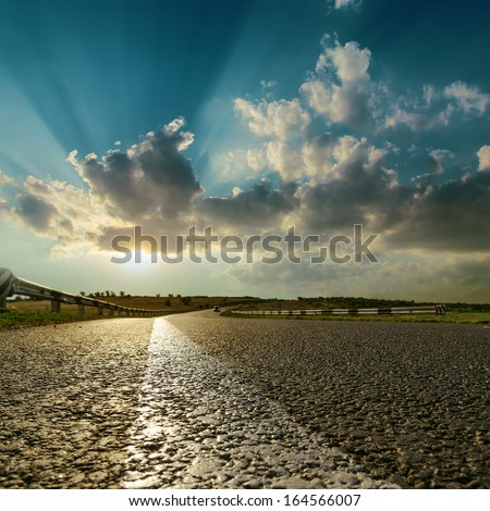 asphalt road close up to sunset - stock photo