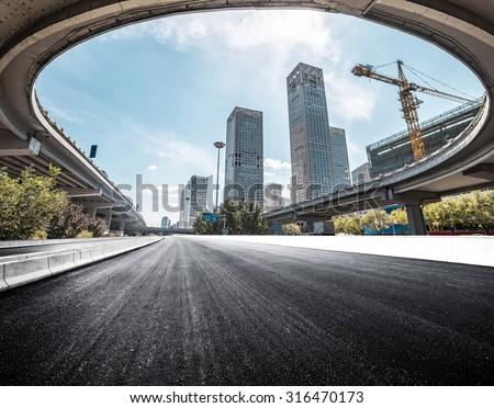 asphalt road in Beijing CBD - stock photo