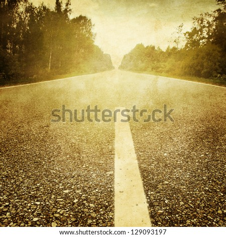 Asphalt road in grunge and retro style. - stock photo