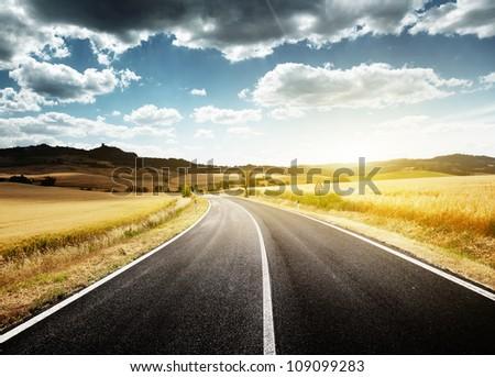 asphalt road in Tuscany Italy - stock photo