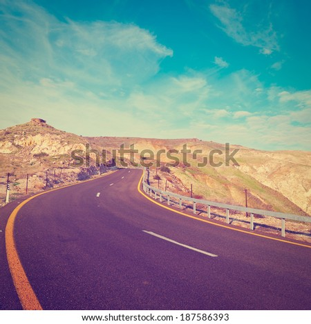 Asphalt Road on the Golan Heights in Israel, Instagram Effect - stock photo