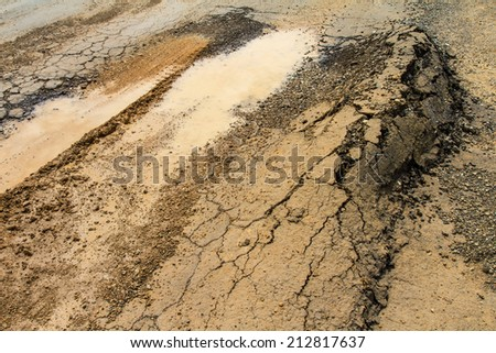 Asphalt road surface collapse due to the weight and water. - stock photo