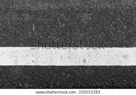 Asphalt road texture with white line - stock photo