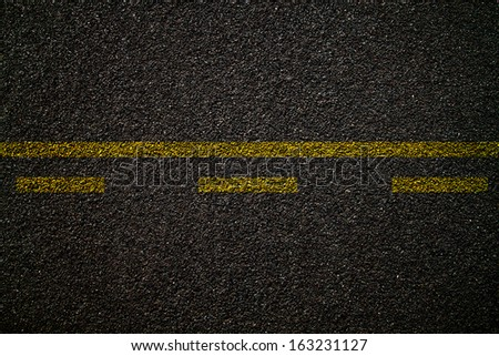 Asphalt road texture,yellow line on road - stock photo