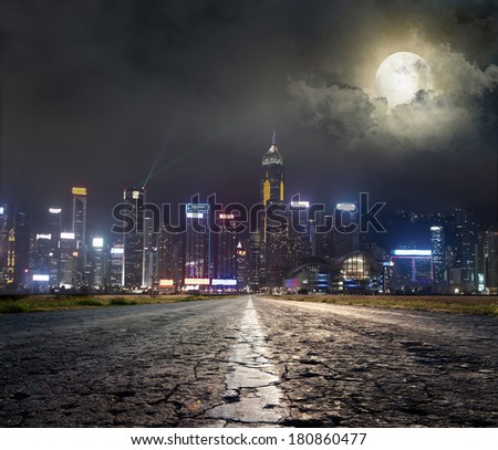 Asphalt road to city under - stock photo