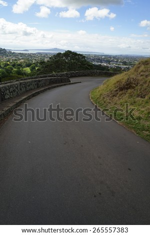 Asphalt road to horizon with cloudy sky in New Zealand. - stock photo