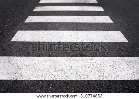 Asphalt road top view with a white line - stock photo