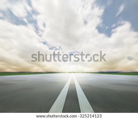 asphalt road under cloud sky  - stock photo