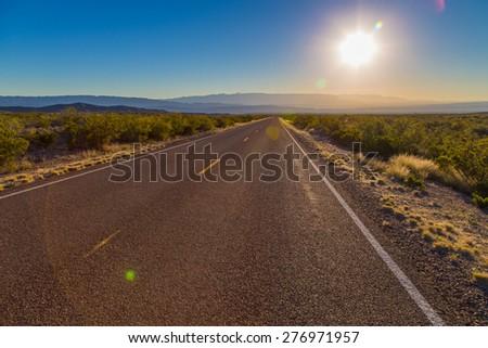 asphalt road with blue sky - stock photo