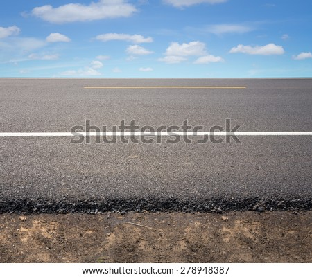 Asphalt road with blue sky background. - stock photo