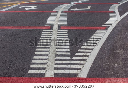 Asphalt road with dividing lines and tire tracks. Background photo texture - stock photo