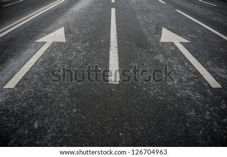 Asphalt road with white stripes - stock photo