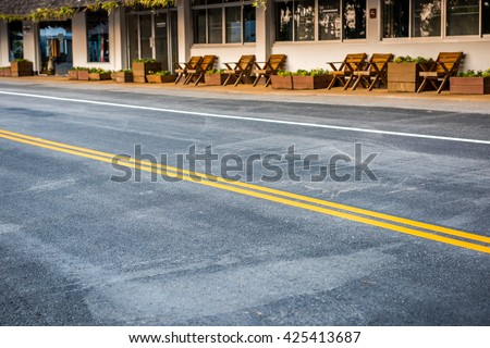 Asphalt road, yellow line on the new road - stock photo