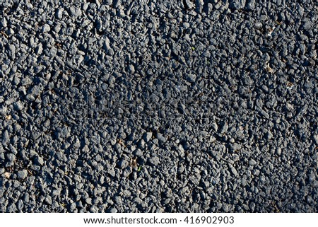 Asphalt texture close up can be used for background - stock photo