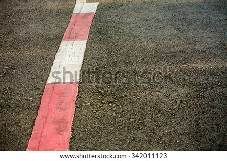asphalt texture with red and white line marking - stock photo