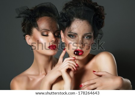 Aspiration. Hanker. Two Sexy Desirable Women in Erotic Embrace Hugging - stock photo