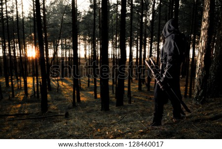 assassin in the deep forest - stock photo