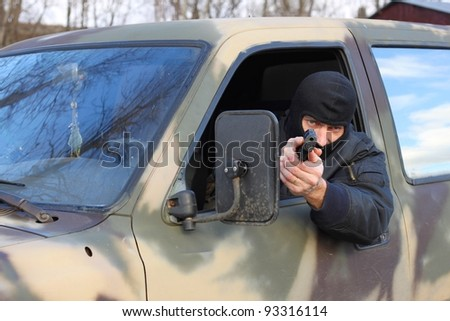 assassin shooting from a moving car - stock photo
