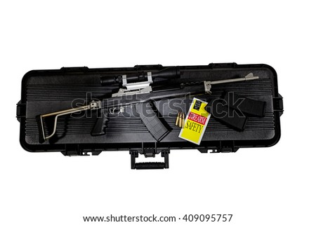 Assault combat automatic rifle high capacity with scope and case safety brochure and ammunition - stock photo