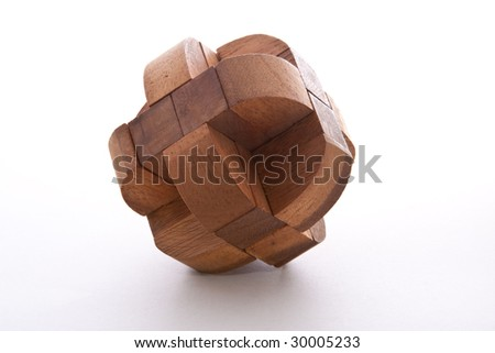 Assembled wooden burr puzzle on white background - stock photo