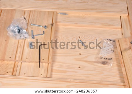 Assembling furniture with using tools - stock photo