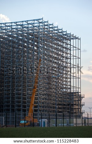 Assembly of steel structure of warehouse - stock photo